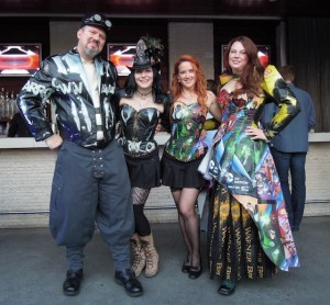 Nicole Fullerton, right, with fellow Comic-Con-goers, shows off her bespoke tote bag fashions (photo credit: Eve Weston)